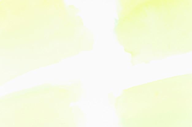 Textura de respingo de lavagem aquarela amarela isolada no pano de fundo branco Foto gratuita