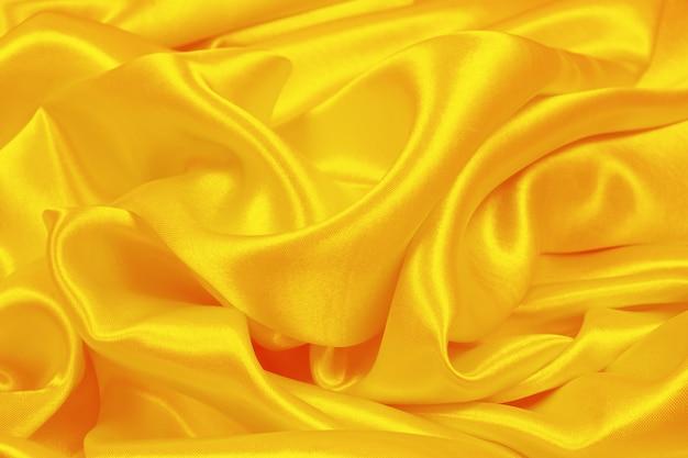 Textura de seda laranja luxuoso cetim para abstrato Foto Premium