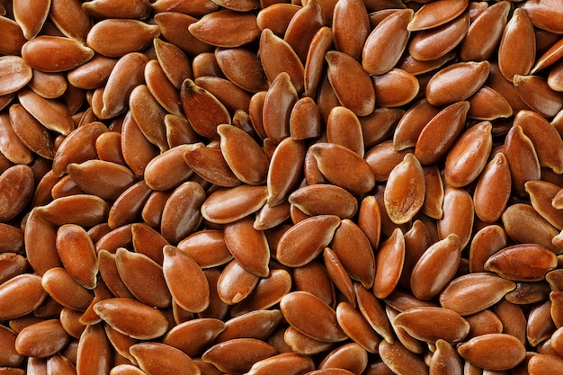 Textura de sementes de linho marrom escuro. Foto Premium