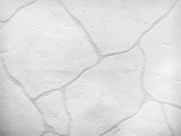 Textura de superfície de parede de pedra branca como pano de fundo. Foto Premium