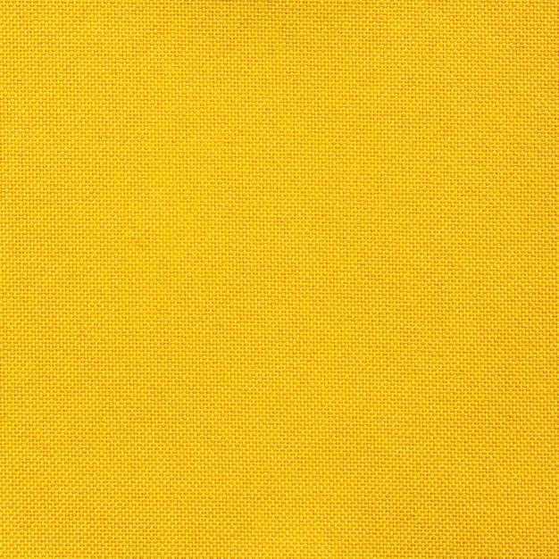 Textura de tecido amarelo sem costura para o fundo Foto gratuita