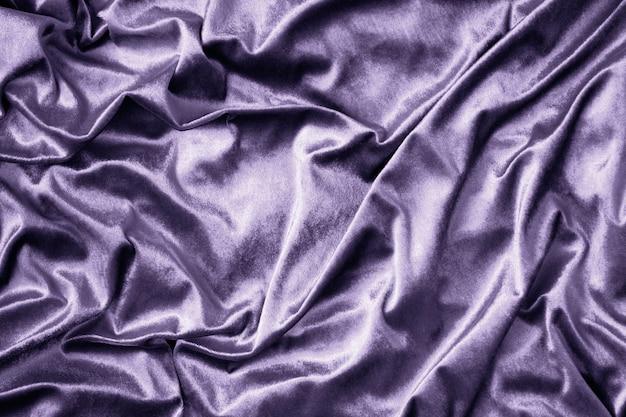 Textura de tecido de seda brilhante roxo Foto gratuita