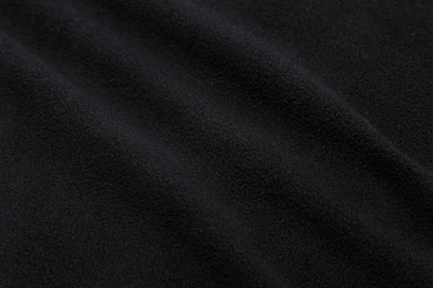 Textura de tecido preto, pano de fundo. Foto Premium