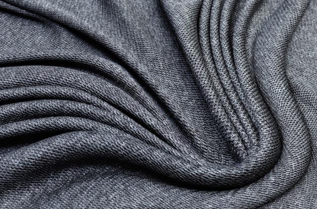 Textura de tecido, textura close-up de tecido preto ou jersey para plano de fundo de web design Foto Premium