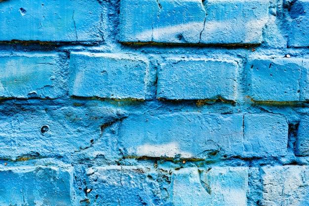 Textura de tijolos com arranhões e rachaduras Foto Premium