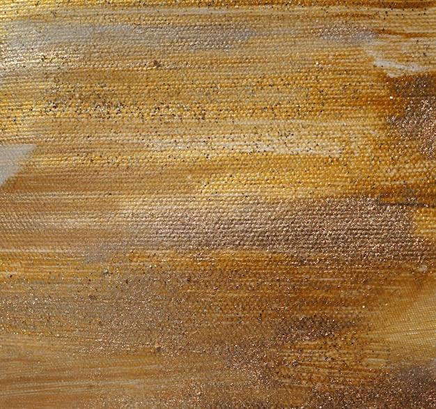Textura de tinta glitter dourados Foto Premium