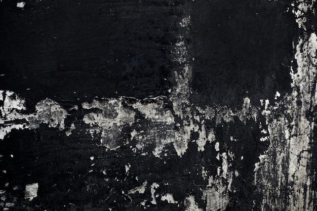 Textura de tinta preta velha descascando a parede de concreto Foto Premium