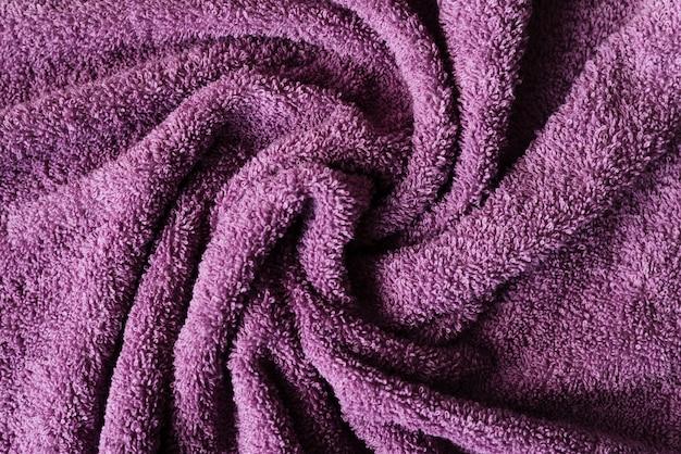 Textura de toalha roxa de vista superior Foto gratuita