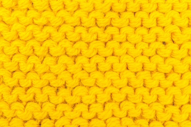 Textura de tricô para cor amarela Foto Premium