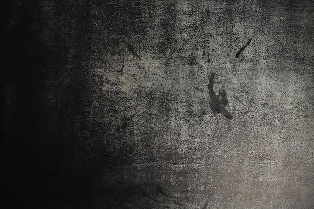 Textura de um quadro de giz em ardósia cinza escuro preto muito usado Foto gratuita