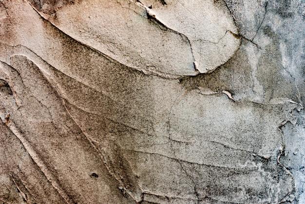 Textura de uma parede de concreto com rachaduras e arranhões Foto Premium