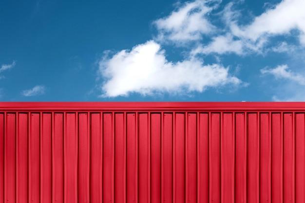 Textura do contêiner de navio de carga vermelho localizado com fundo de céu azul Foto Premium