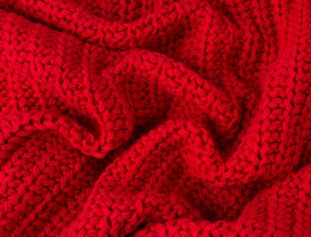 Textura do fim feito malha vermelho da tela acima. malhas de lã Foto Premium