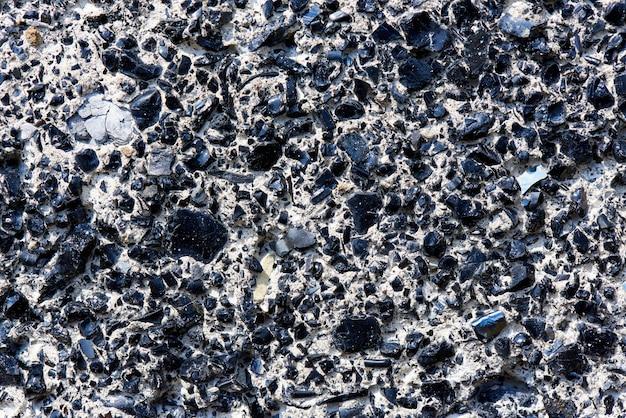 Textura do fundo da superfície contínua com close-up das rochas. Foto Premium