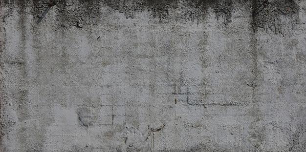 Textura do muro de cimento gravado velho na cor cinzenta. fundo Foto Premium