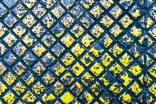 Textura e fundo da cor amarela da placa de metal Foto Premium