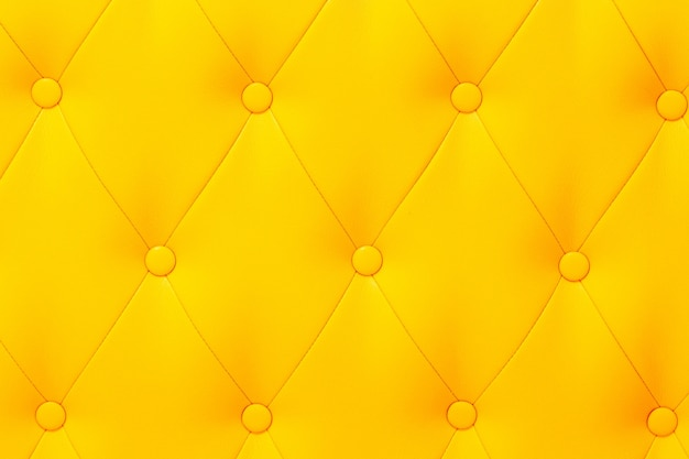 Textura elegante de couro amarelo brilhante saturado da poltrona. Foto Premium