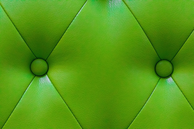 Textura elegante de couro verde com botões para padrão e plano de fundo. Foto Premium