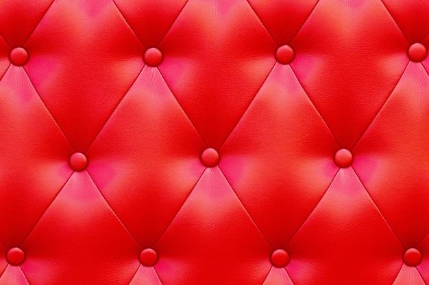Textura elegante de couro vermelho brilhante saturado da poltrona. Foto Premium