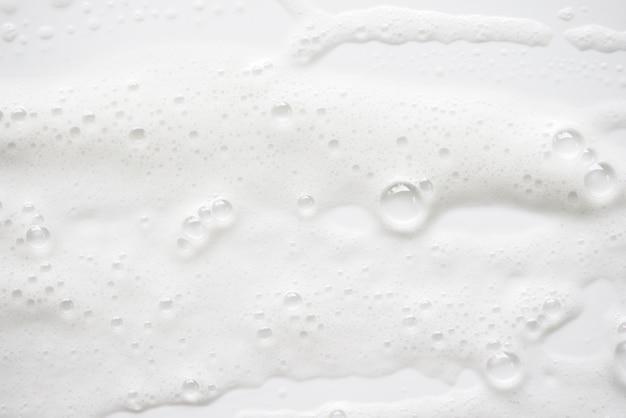 Textura ensaboada branca abstrata da espuma. espuma de champô com bolhas Foto Premium