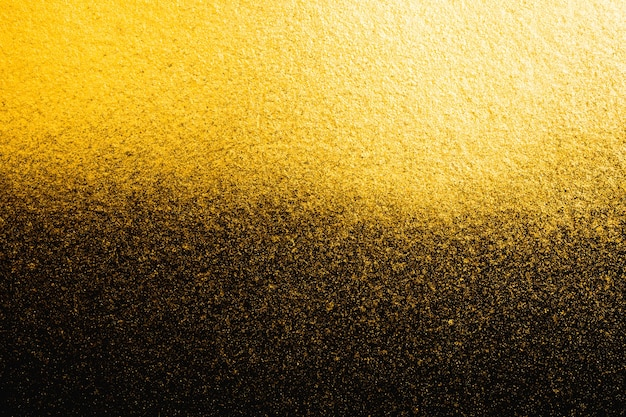 Textura granulada abstrata dourada no fundo preto Foto Premium