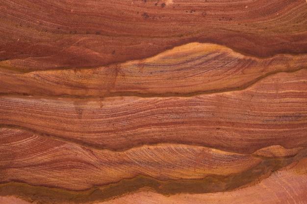 Textura natural de pedras vermelhas. canyon colorido, egito, península do sinai. Foto Premium