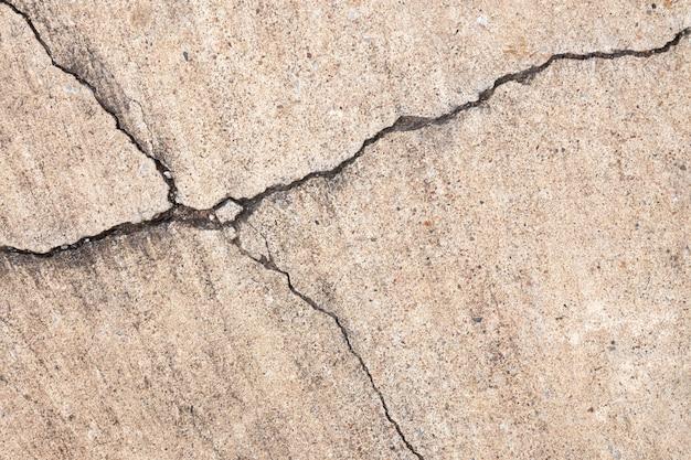 Textura rachada do cimento no fundo do assoalho ou da parede. Foto Premium