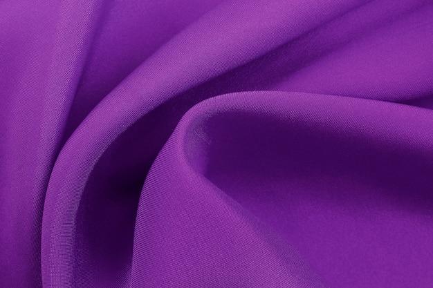Textura roxa da tela para o fundo e o projeto, teste padrão bonito da seda ou linho. Foto Premium