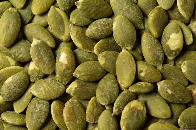 Textura verde macro das sementes de abóbora. Foto gratuita