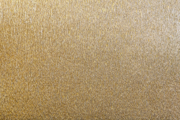 Textural do fundo dourado do papel ondulado ondulado, close up. Foto Premium