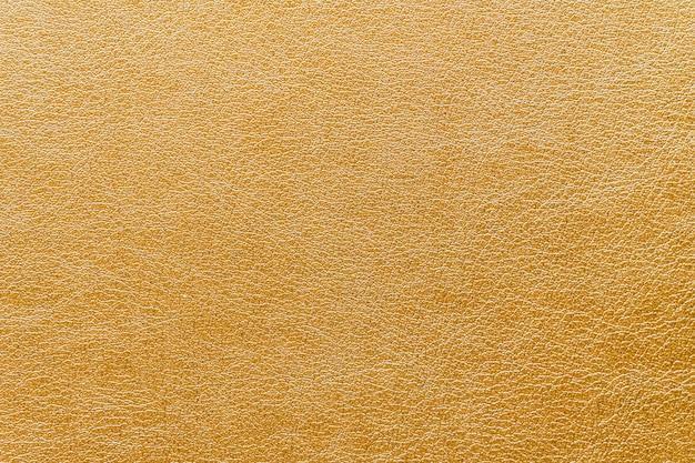 Texturas de couro ouro abstrato Foto gratuita