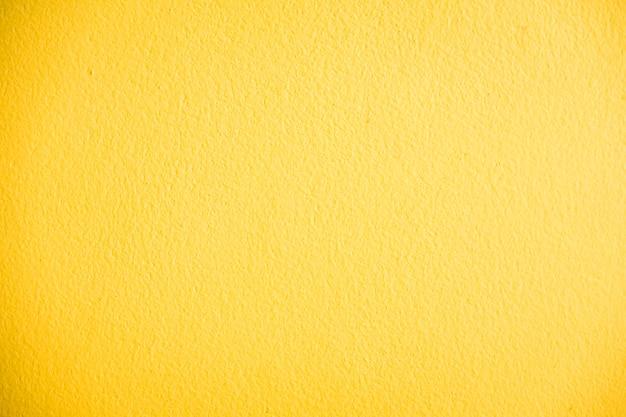 Texturas de parede de concreto amarelo Foto gratuita