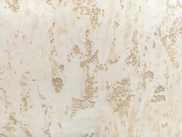 Texture o emplastro bege decorativo que imita a parede velha da casca. Foto Premium