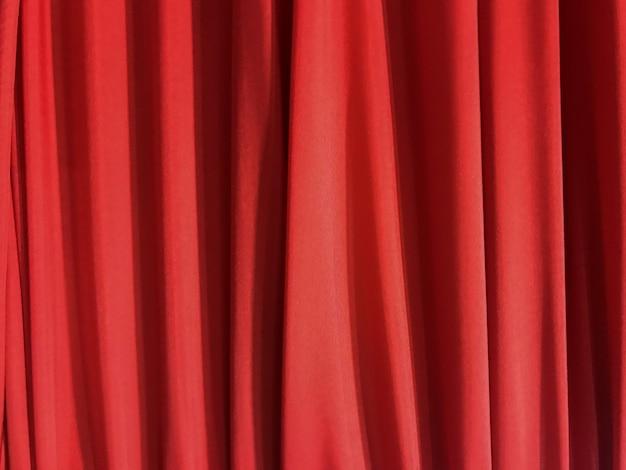 Texturebackground vermelho de pano luxuoso de tecelagem vertical da tela da curva. Foto Premium