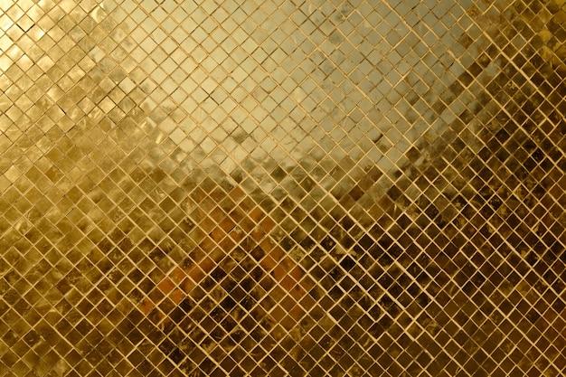 Texure de rico mosaico dourado close-up Foto Premium