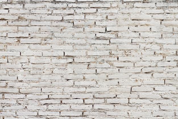 Tijolos antigos de paredes de edifícios urbanos Foto gratuita