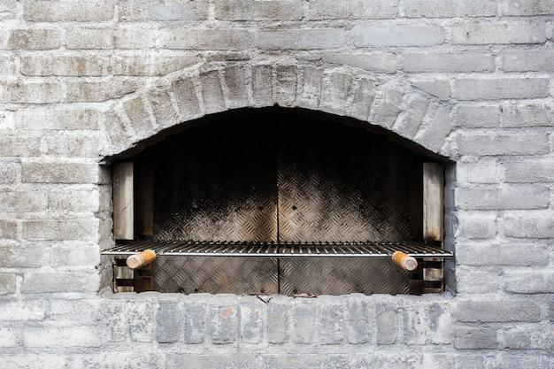 Tijolos de close-up cinza tradicional forno de pedra Foto Premium