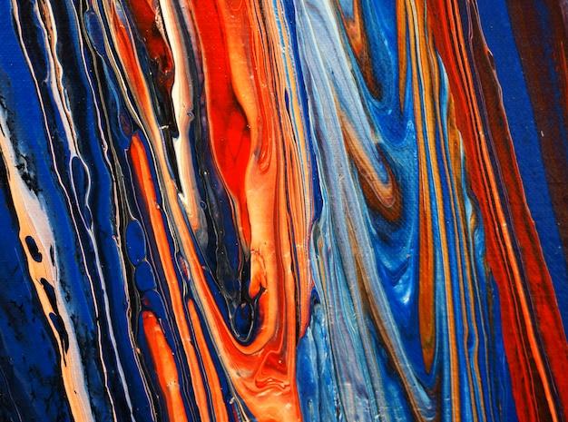 Tinta a óleo colorida que flui na lona Foto Premium