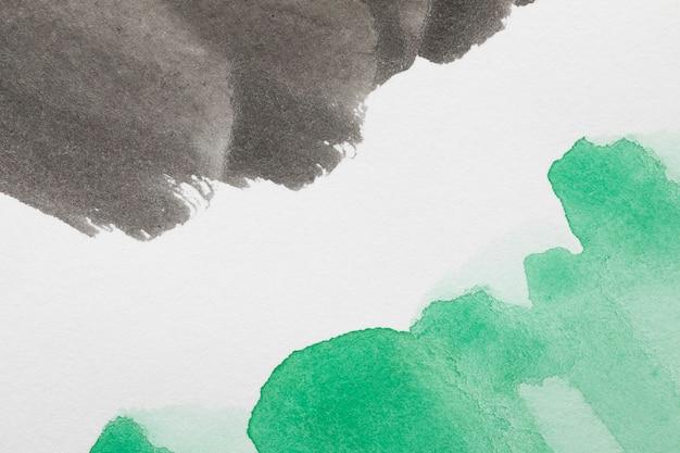 Tinta abstrata cores contrastadas na superfície branca Foto gratuita