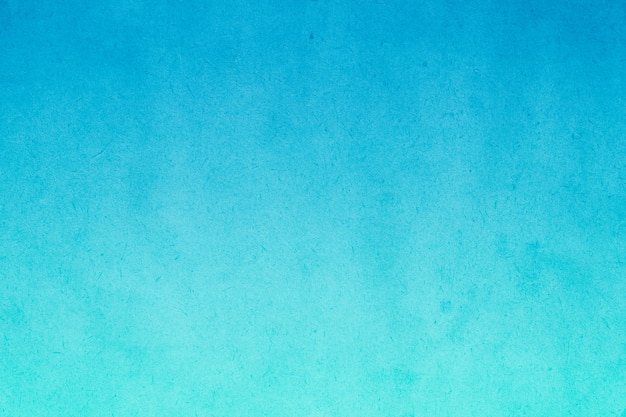 Tinta aquarela gradiente azul em papel velho com resumo de textura suja de manchas de grãos para plano de fundo Foto Premium