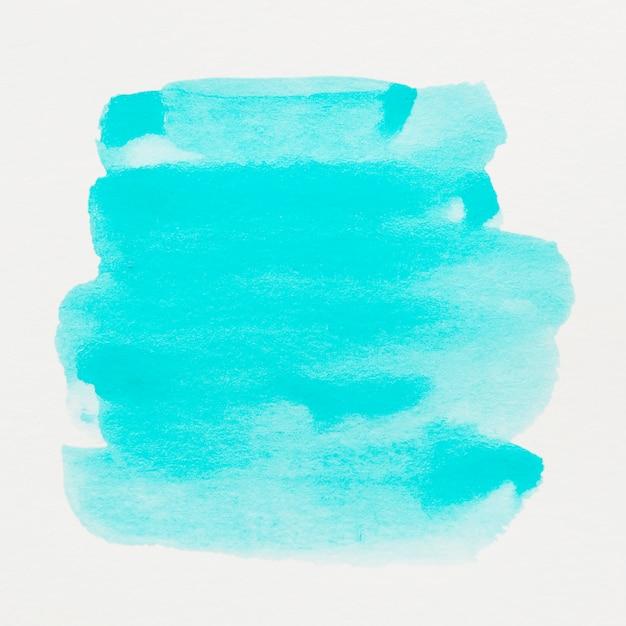 Tinta aquarela turquesa em abstrato Foto gratuita