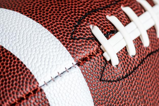 Tiro macro de fundo de bola de futebol americano Foto gratuita
