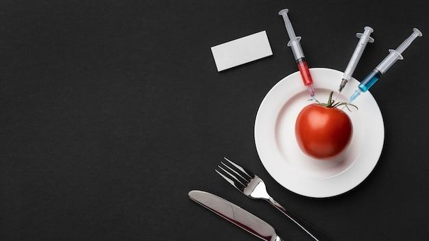Tomates deliciosos alimentos modificados por gm Foto gratuita