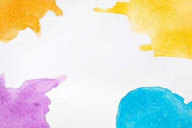 Tons de cores quentes e frias manchas pintadas à mão Foto gratuita
