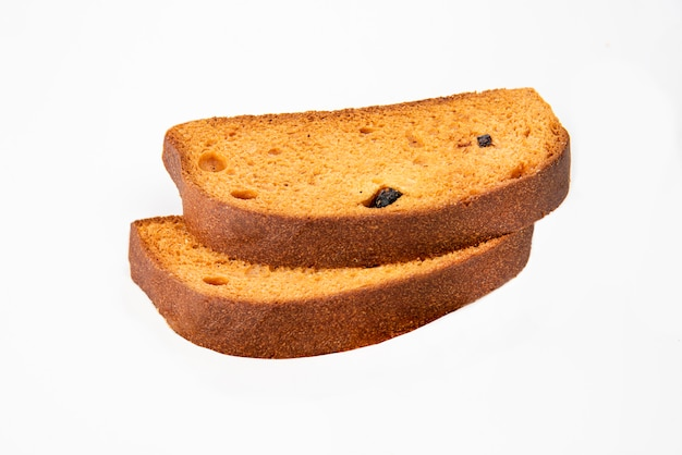Torrada de pão na mesa branca Foto Premium