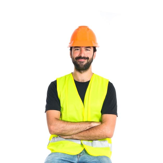 Trabalhador com os braços cruzados sobre fundo branco Foto gratuita