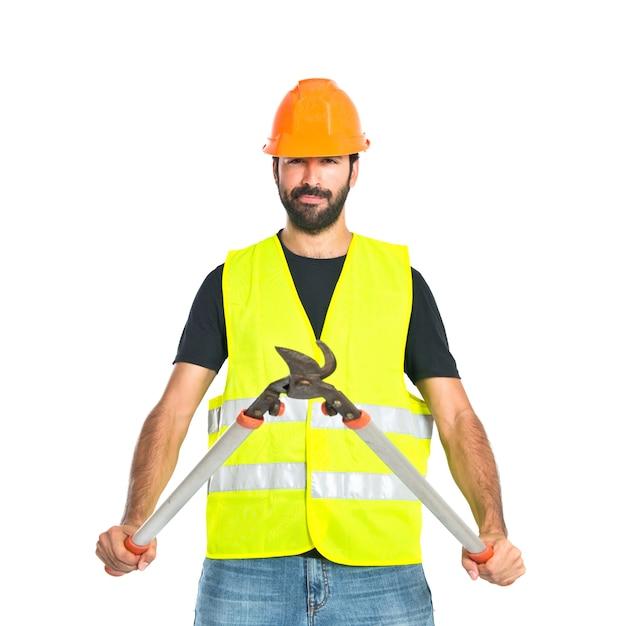 Trabalhador com tesoura segadeira sobre fundo branco Foto gratuita