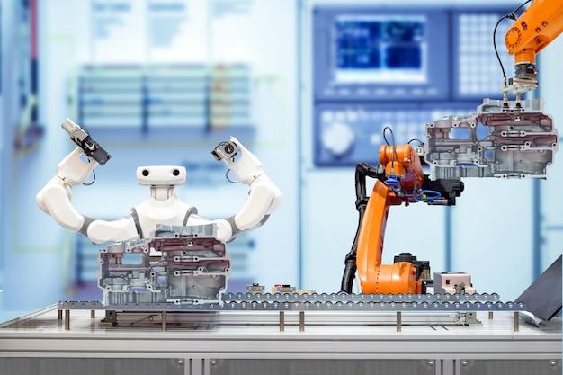 Trabalho em equipe robótico industrial trabalhando com peças de motor de moto via transportadora na fábrica inteligente turva azul Foto Premium