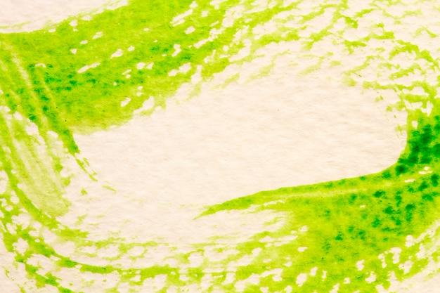 Traçado verde do pincel em papel branco Foto Premium