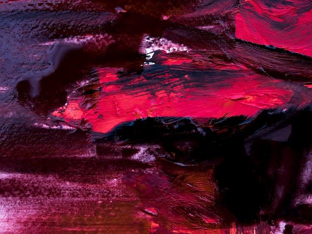 Traçados de pincel sujos de rosa e pretos na lona Foto gratuita
